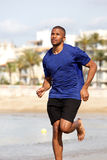 Healthy young african american man running at beach Royalty Free Stock Image