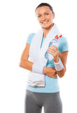 Portrait of a healthy young woman holding bottle of  water again. A beautiful sports female wearing sports clothes isolated on white background Royalty Free Stock Photos