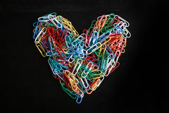 Heart shaped colorful paper clips Royalty Free Stock Image