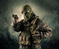 Portrait of a heavily armed masked soldier with grungy backgroun Royalty Free Stock Images