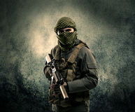 Portrait of a heavily armed masked soldier with grungy backgroun Royalty Free Stock Photography