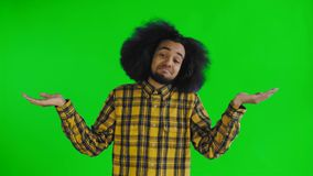Portrait of helpless african american man throwing hands aside and shrugging dont know or cant help on green screen or. Chroma key background. Concept of stock video