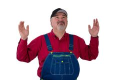 Portrait of helpless gardener wearing dungarees Stock Image