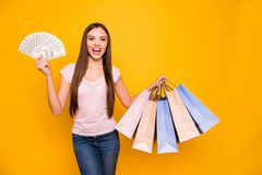 Portrait of her she nice cute charming attractive rich wealthy cheerful cheery straight-haired girl holding in hands new. Cool bags purchase deposit isolated on royalty free stock photos