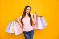 Portrait of her she nice cute charming lovely winsome sweet adorable attractive cheerful straight-haired girl holding in. Hands colorful bags isolated on bright stock images