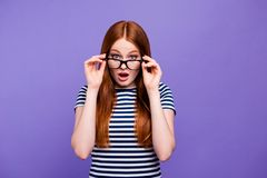 Portrait of her she nice-looking attractive charming cute lovely winsome confused youngster lady looking putting glasses. Off isolated over bright vivid shine stock photography