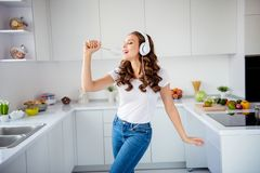 Portrait of her she nice-looking attractive lovely charming cheerful cheery wavy-haired girl holding in hand kitchenware royalty free stock photos