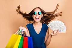 Portrait of her she nice-looking attractive lovely cheerful glad straight-haired lady holding in hands bags with new. Look clothing 100 atm income interest wind royalty free stock images