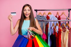 Portrait of her she nice-looking attractive lovely cheerful positive straight-haired lady holding in hands new bags cool. Things plastic card closet isolated royalty free stock images