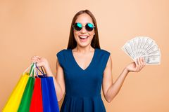 Portrait of her she nice-looking attractive lovely groomed cheerful cheery glad straight-haired lady holding in hands. Bags with new look clothing 100 atm stock photo
