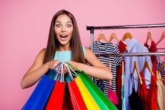 Portrait of her she nice-looking attractive shine lovely adorable cheerful cheery positive straight-haired lady holding. In hands new bags things isolated over stock image