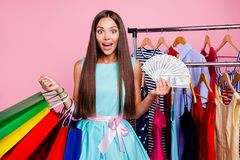 Portrait of her she nice-looking attractive sweet lovely cheerful cheery straight-haired lady holding in hands new bags. Cool things closet spend salary stock image