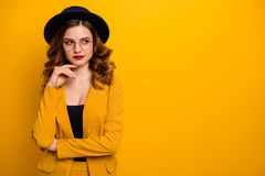 Portrait of her she nice-looking charming cute attractive lovely chic luxury elegant minded wavy-haired lady in yellow. Jacket copy space isolated on bright stock image