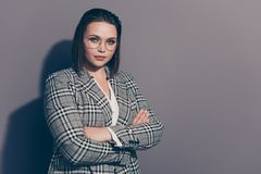 Portrait of her she nice-looking lovely beautiful attractive classy chic candid lady wearing checked blazer folded arms. Day everyday career growth isolated stock photo