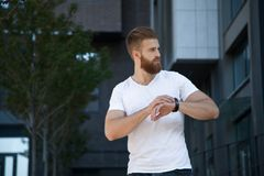 Young modern bearded man looking away royalty free stock photos