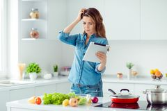 Portrait of her she nice lovely attractive confused brown-haired lady thinking how to prepare fresh hot dish meal dinner royalty free stock photography