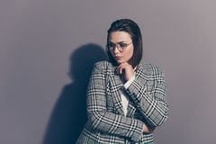 Portrait of her she nice lovely beautiful attractive classy decisive lady wearing checked blazer touching chin thinking. Isolated over gray violet purple pastel stock images