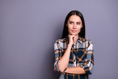 Portrait of her she nice pretty attractive winsome minded straight-haired lady wearing checked plaid looking aside. Touching chin copy space isolated over gray royalty free stock image