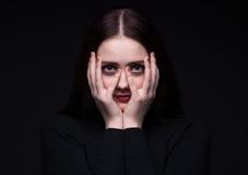Portrait of hiding brunette woman Royalty Free Stock Images