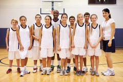 Portrait Of High School Sports Team In Gym With Coach Royalty Free Stock Image