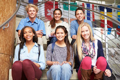 Portrait Of High School Students Sitting Outside Building Royalty Free Stock Photography