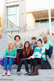 Portrait Of High School Students Sitting Outside Building Royalty Free Stock Photo