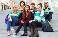 Portrait Of High School Students Sitting Outside Building Royalty Free Stock Images
