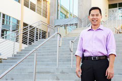 Portrait Of High School Teacher Standing Outside Building Stock Photos