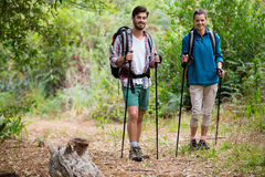 Portrait of hiker couple standing with hiking pole Stock Image