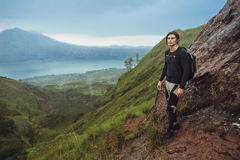 Portrait of hiker man posing on the mountain, freedom concept. A Royalty Free Stock Images