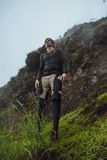 Portrait of hiker man posing on the mountain, freedom concept. A Stock Photos