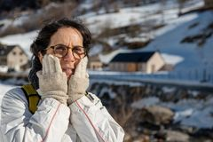 Portrait of hiker mature woman in the snow stock images