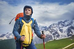 Portrait of hiker in mountains in sportswear. Tourist is on hiking trek. Adventure hike along hills and mountains Stock Photo