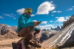 Portrait of hiker woman GPS navigator in mountains Stock Photography