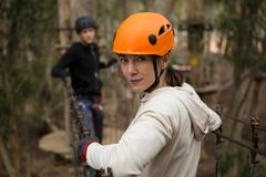Portrait of hiker woman holding zip line in forest Stock Photography