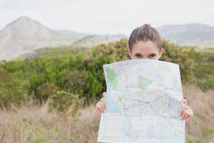 Portrait of a hiking young woman holding map Stock Images