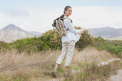 Portrait of a hiking young woman holding map Stock Photography