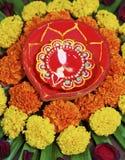 Portrait Hindu floral rangoli Diva marigolds Stock Images