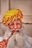 Portrait of a Hindu man smoking a pipe at Mehrangarh Fort, Jodhpur, Rajasthan, India Stock Photos