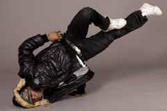 Portrait of hip hop dancer in head stand Stock Images