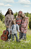 Portrait of hippie family outdoors Stock Image