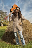 Portrait of hippie man with a guitar Stock Photography