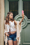Portrait of hippie woman in boho clothes making selfie Royalty Free Stock Photos