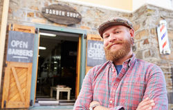 Portrait Of Hipster Barber Standing Outside Shop Royalty Free Stock Image