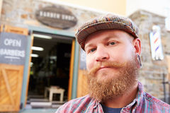 Portrait Of Hipster Barber Standing Outside Shop Royalty Free Stock Images