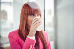 Portrait of a hipster businesswoman drinking a coffee cup Royalty Free Stock Photos