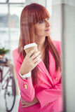 Portrait of a hipster businesswoman drinking a coffee cup Stock Photo