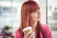 Portrait of a hipster businesswoman drinking a coffee cup Royalty Free Stock Photography