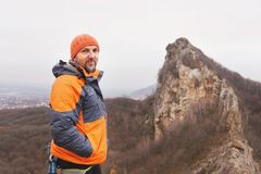 Portrait of a rock climber aged and with a beard against the backdrop of sharp mountain in the northern Caucasus Royalty Free Stock Photo
