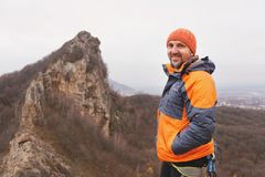 Portrait of a rock climber aged and with a beard against the backdrop of sharp mountain in the northern Caucasus Stock Images